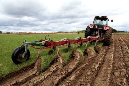13584418 - ploughing on a cloudy spring afternoon